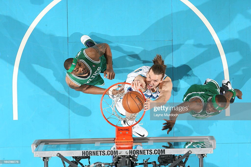 Lou Amundson #17 of the New Orleans Hornets dunks against the Boston Celtics on March 20, 2013 at the New Orleans Arena in New Orleans, Louisiana.
