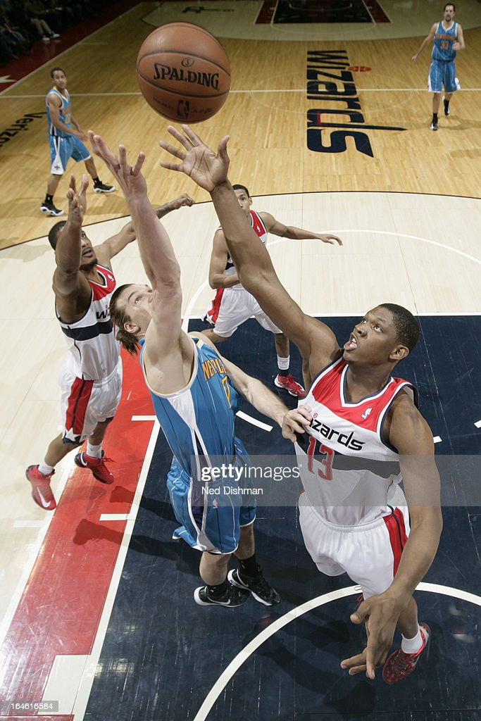 Lou Amundson #17 of the New Orleans Hornets goes up for a rebound against <a gi-track='captionPersonalityLinkClicked' href=/galleries/search?phrase=Kevin+Seraphin&family=editorial&specificpeople=6474998 ng-click='$event.stopPropagation()'>Kevin Seraphin</a> #13 of the Washington Wizards at the Verizon Center on March 15, 2013 in Washington, DC.