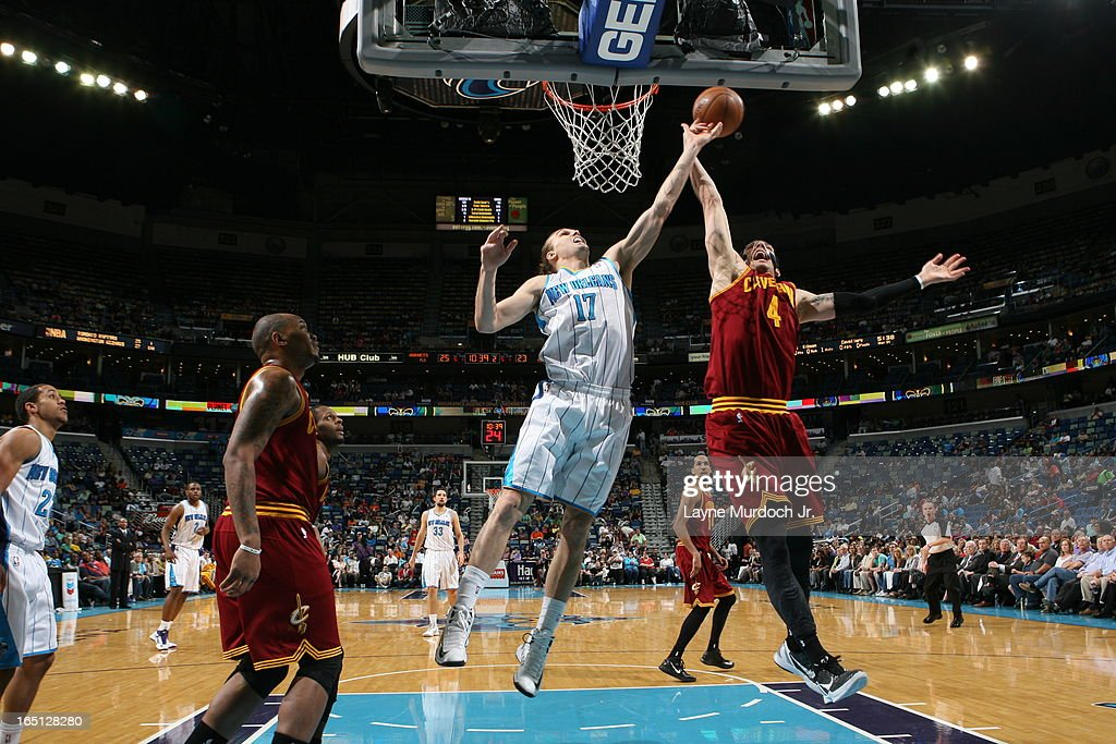 Lou Amundson #17 of the New Orleans Hornets goes up for a rebound against Luke Walton #4 of the Cleveland Cavaliers on March 31, 2013 at the New Orleans Arena in New Orleans, Louisiana.