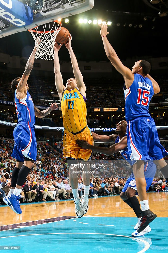 Lou Amundson #17 of the New Orleans Hornets rises for a dunk against Matt Barnes #22 and Ryan Hollins #15 of the Los Angeles Clippers on April 12, 2013 at the New Orleans Arena in New Orleans, Louisiana.
