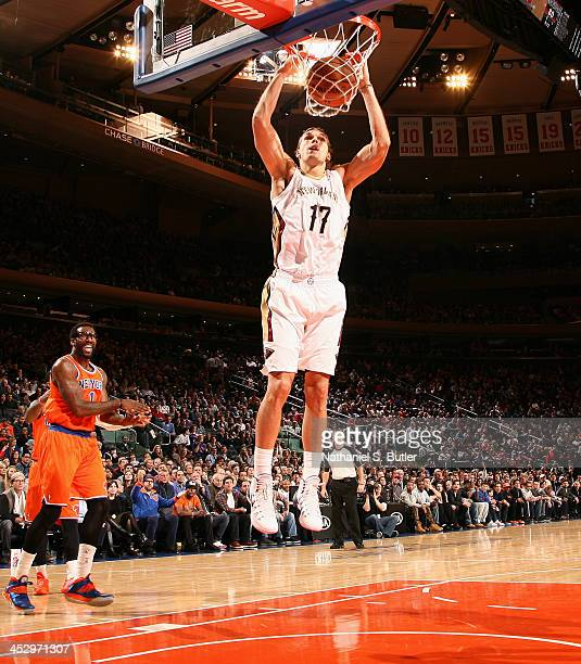 Lou Amundson of the New Orleans Pelicans dunks during a game against the New York Knicks at Madison Square Garden in New York City on December 1 2013...