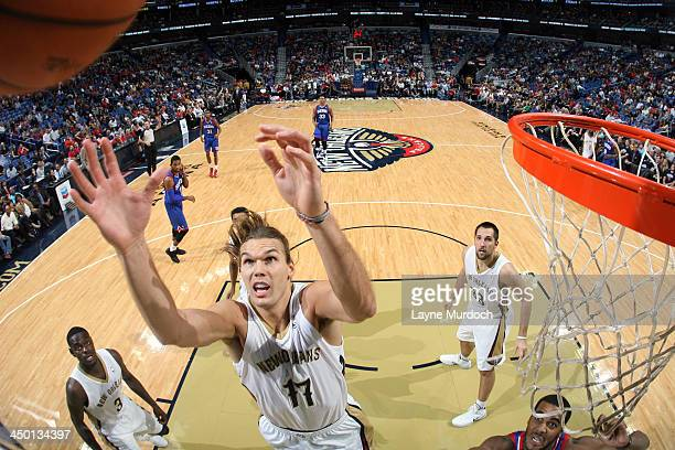 Lou Amundson of the New Orleans Pelicans grabs a rebound against the Philadelphia 76ers on November 16 2013 at the New Orleans Arena in New Orleans...