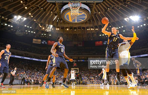 Lou Amundson of the New Orleans Pelicans rebounds against Marreese Speights of the Golden State Warriors on December 17 2013 at Oracle Arena in...