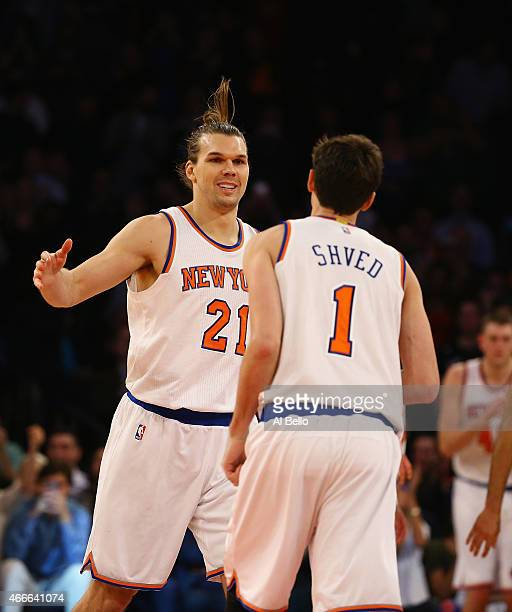 Lou Amundson of the New York Knicks celebrates his game tying basket with Alexey Shved forcing the game into overtime against the San Antonio Spurs...