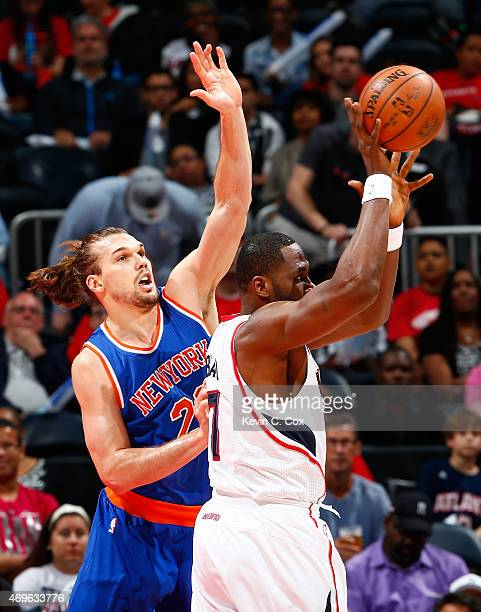 Lou Amundson of the New York Knicks defends against Elton Brand of the Atlanta Hawks at Philips Arena on April 13 2015 in Atlanta Georgia NOTE TO...