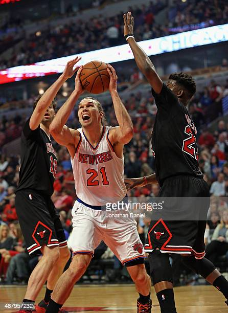 Lou Amundson of the New York Knicks gets between defenders Pau Gasol and Jimmy Butler of the Chicago Bulls at the United Center on March 28 2015 in...