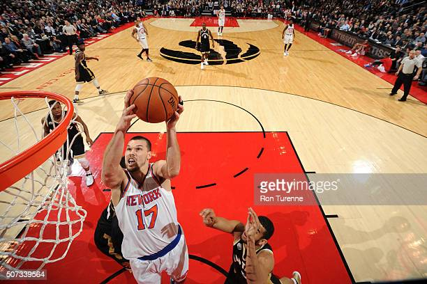 Lou Amundson of the New York Knicks goes for the layup during the game against the Toronto Raptors on January 28 2016 at the Air Canada Centre in...