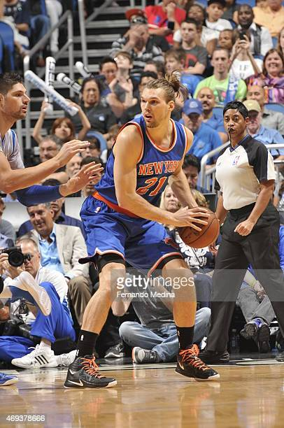 Lou Amundson of the New York Knicks handles the ball against the Orlando Magic on April 11 2015 at Amway Center in Orlando Florida NOTE TO USER User...