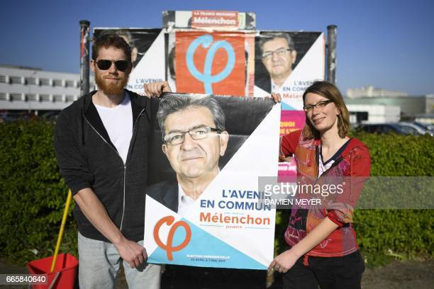 Lou and Enora supporters of French presidential election candidate for the farleft coalition 'La France insoumise' JeanLuc Melenchon pose with an...