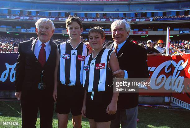 Lou and Ron Richards pose with their grandchildren prior to the round six AFL match between Carlton Blues and Collingwood Magpies at MCG on May 6...