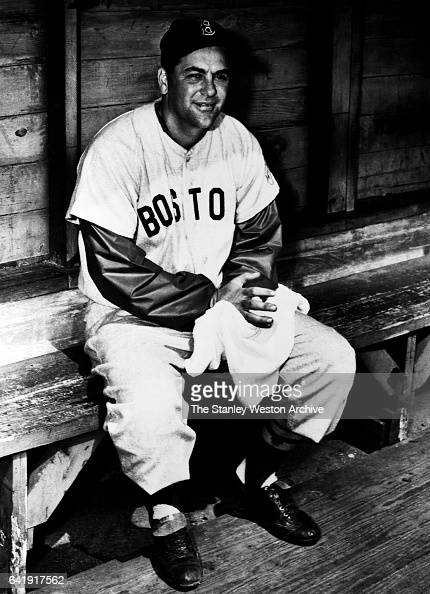 Lou Boudreau shortstop of the Boston Red Sox sitting in the dugout circa 1951
