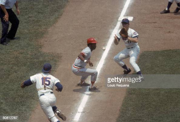 Lou Brock of the St Louis Cardinals gets caught in a rundown between third base and home during a game against the New York Mets at Shea Stadium in...