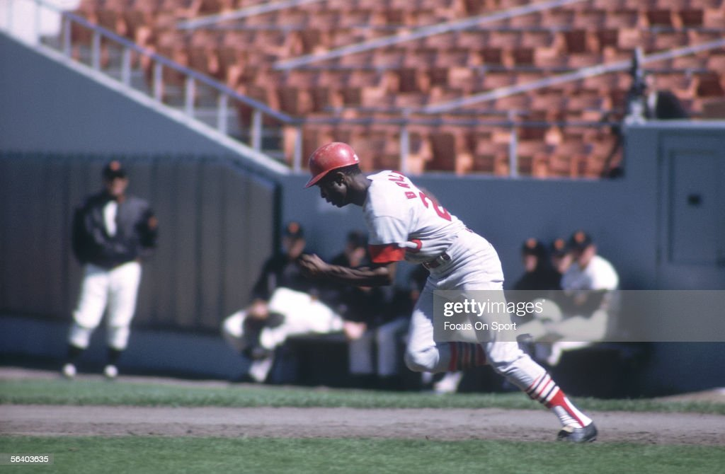 Lou Brock of the St Louis Cardinals runs for second base against the San Francisco Giants during a game at Candlestick Park circa the 1960's in San...