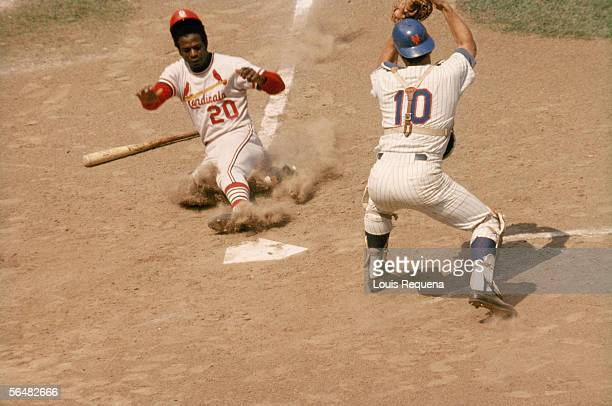 Lou Brock of the St Louis Cardinals slides into home plate during a game circa 1964 to 1979 Lou Brock played for the St Louis Cardinals from 19641979