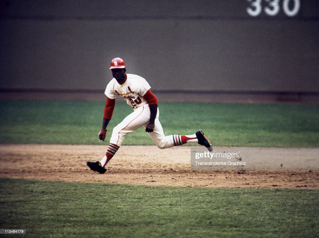 <a gi-track='captionPersonalityLinkClicked' href=/galleries/search?phrase=Lou+Brock&family=editorial&specificpeople=207012 ng-click='$event.stopPropagation()'>Lou Brock</a> stealing another base during a game at Busch Stadium circa 1973 in St. Louis, Missouri.