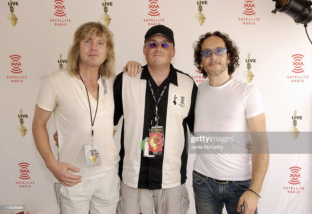 Lou Brutus (center) with <a gi-track='captionPersonalityLinkClicked' href=/galleries/search?phrase=Vivian+Campbell&family=editorial&specificpeople=559341 ng-click='$event.stopPropagation()'>Vivian Campbell</a> and <a gi-track='captionPersonalityLinkClicked' href=/galleries/search?phrase=Rick+Savage&family=editorial&specificpeople=221614 ng-click='$event.stopPropagation()'>Rick Savage</a> of <a gi-track='captionPersonalityLinkClicked' href=/galleries/search?phrase=Def+Leppard&family=editorial&specificpeople=614448 ng-click='$event.stopPropagation()'>Def Leppard</a>