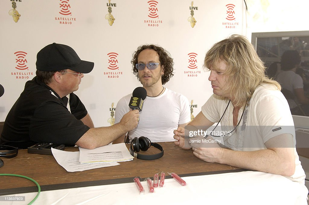 Lou Brutus with <a gi-track='captionPersonalityLinkClicked' href=/galleries/search?phrase=Vivian+Campbell&family=editorial&specificpeople=559341 ng-click='$event.stopPropagation()'>Vivian Campbell</a> and <a gi-track='captionPersonalityLinkClicked' href=/galleries/search?phrase=Rick+Savage&family=editorial&specificpeople=221614 ng-click='$event.stopPropagation()'>Rick Savage</a> of <a gi-track='captionPersonalityLinkClicked' href=/galleries/search?phrase=Def+Leppard&family=editorial&specificpeople=614448 ng-click='$event.stopPropagation()'>Def Leppard</a>