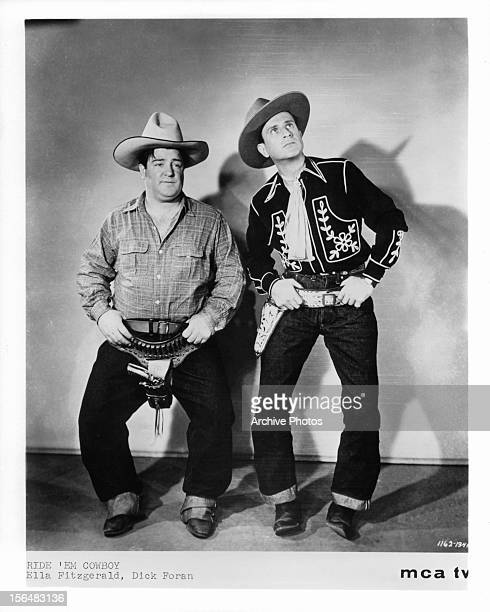Lou Costello and Bud Abbott pose as cowboys in a publicity portrait for the film 'Ride 'Em Cowboy' 1942