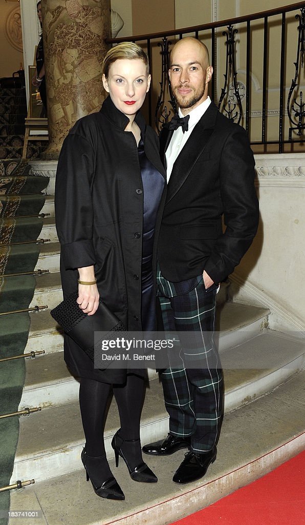 Lou Dalton (L) and Justin Haig arrive at the Scottish Fashion Invasion of London at the 8th Annual Scottish Fashion Awards 2013 at Dover House on October 9, 2013 in London, England.