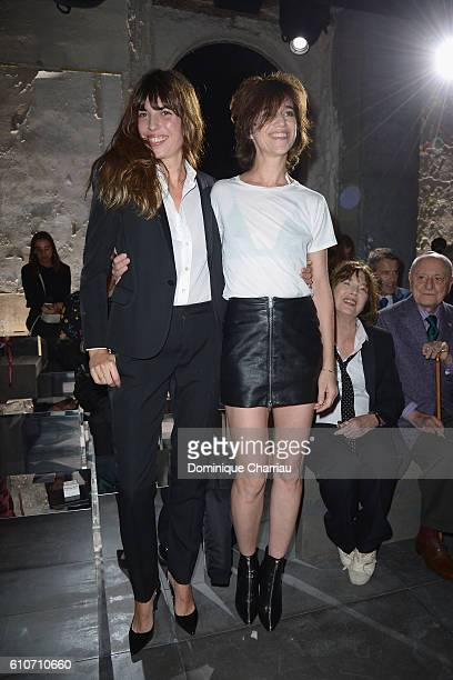 Lou Doillon and Charlotte Gainsbourg attend the Saint Laurent show as part of the Paris Fashion Week Womenswear Spring/Summer 2017 on September 27...