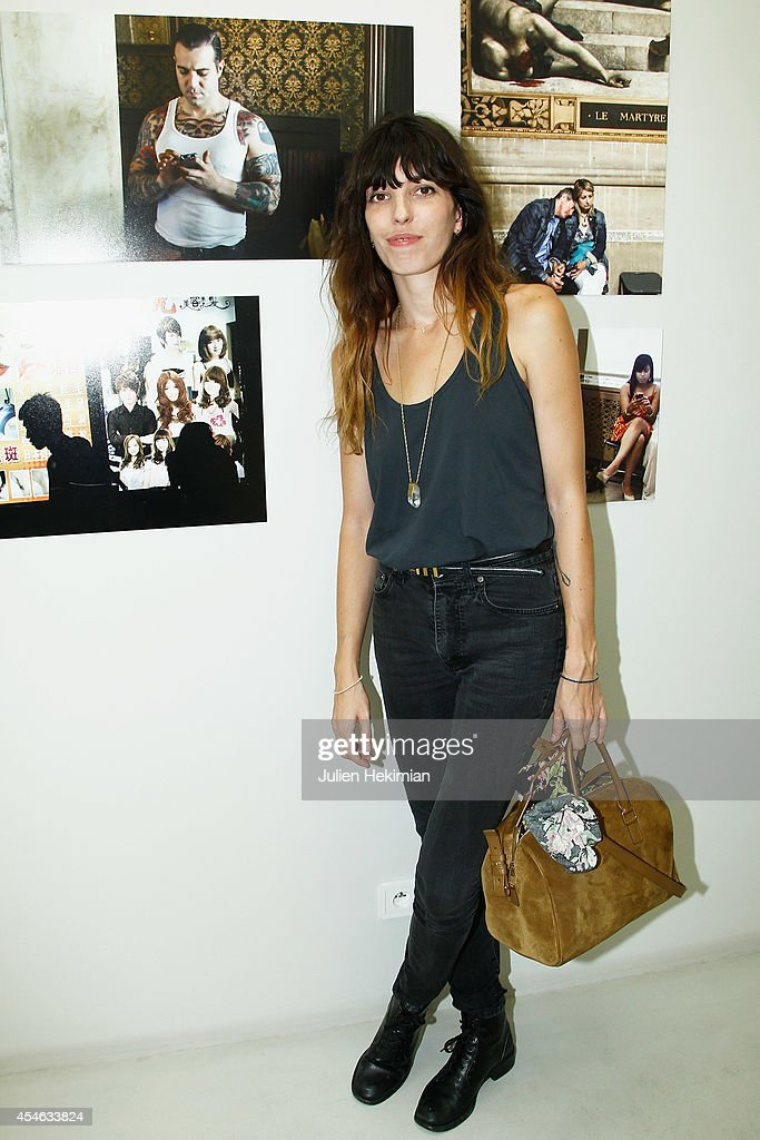 <a gi-track='captionPersonalityLinkClicked' href=/galleries/search?phrase=Lou+Doillon&family=editorial&specificpeople=208822 ng-click='$event.stopPropagation()'>Lou Doillon</a> attends the 'Paris-New York' : Cedric Klapish's Exhibition At Galerie Cinema on September 4, 2014 in Paris, France.