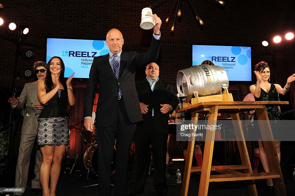 Lou Fratto, Staci Richter, CEO of Reelz Stan E. Hubbard, Dominic Capone, and Julie Alexandria appear onstage at the REELZ Channel upfront presentation at Hudson Hotel on April 9, 2014 in New York City.