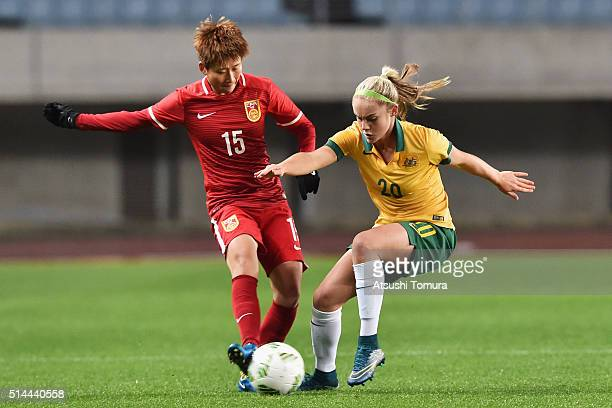 Lou Jiahui of China and Ellie Carpenter of Australia compete for the ball during the AFC Women's Olympic Final Qualification Round match between...