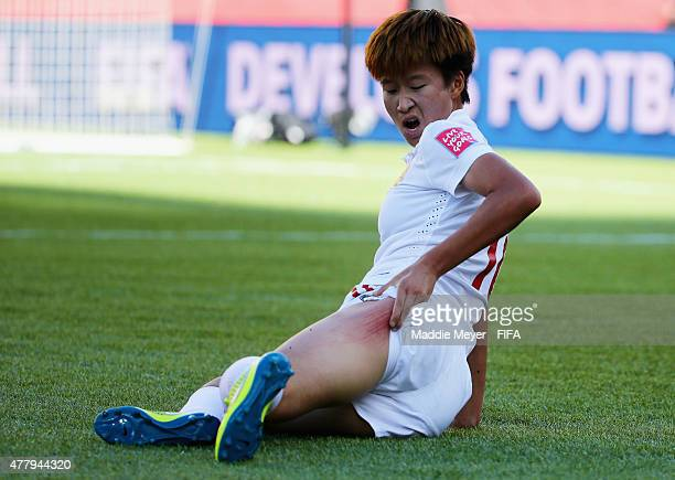 Lou Jiahui of China PR reacts after sliding on the artificial turf during the FIFA Women's World Cup 2015 Round of 16 match between China PR and...