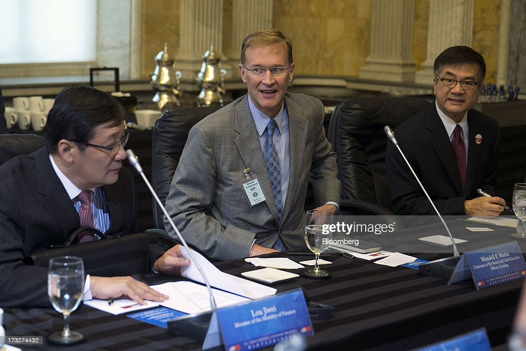 Lou Jiwei, China's finance minister, from left, Wendell Weeks, chief executive officer of Corning Inc., and <a gi-track='captionPersonalityLinkClicked' href=/galleries/search?phrase=Gary+Locke&family=editorial&specificpeople=1792234 ng-click='$event.stopPropagation()'>Gary Locke</a>, U.S. Ambassador to China, attend a chief executive officer roundtable with U.S. and Chinese business leaders during the U.S.-China Strategic and Economic Dialogue (S&ED) conference at the Treasury Department in Washington, D.C., U.S., on Thursday, July 11, 2013. The U.S. and China are meeting this week to find ways to balance a wider flow of investment and goods as their central banks try to prevent excessive risk-taking from derailing the world's biggest economies. Photographer: Andrew Harrer/Bloomberg via Getty Images