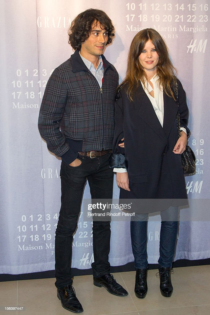 Lou Lesage and her companion Emanuele Fontanesi attend the Maison Martin Margiela for H&M collection launch at H&M Champs Elysees on November 14, 2012 in Paris, France.