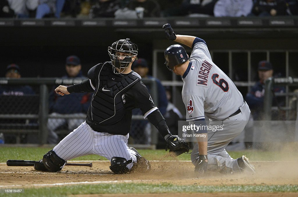 <a gi-track='captionPersonalityLinkClicked' href=/galleries/search?phrase=Lou+Marson&family=editorial&specificpeople=4175358 ng-click='$event.stopPropagation()'>Lou Marson</a> #6 of the Cleveland Indians scores past catcher <a gi-track='captionPersonalityLinkClicked' href=/galleries/search?phrase=A.J.+Pierzynski&family=editorial&specificpeople=204486 ng-click='$event.stopPropagation()'>A.J. Pierzynski</a> #12 of the Chicago White Sox after Shin-Soo Choo #17 grounded out to first base during the seventh inning at U.S. Cellular Field on September 26, 2012 in Chicago, Illinois.