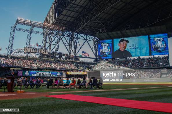 Lou Piniella former manager of the Seattle Mariners is congratulated by Ichiro Suzuki via the scoreboard during ceremonies inducting him into the...