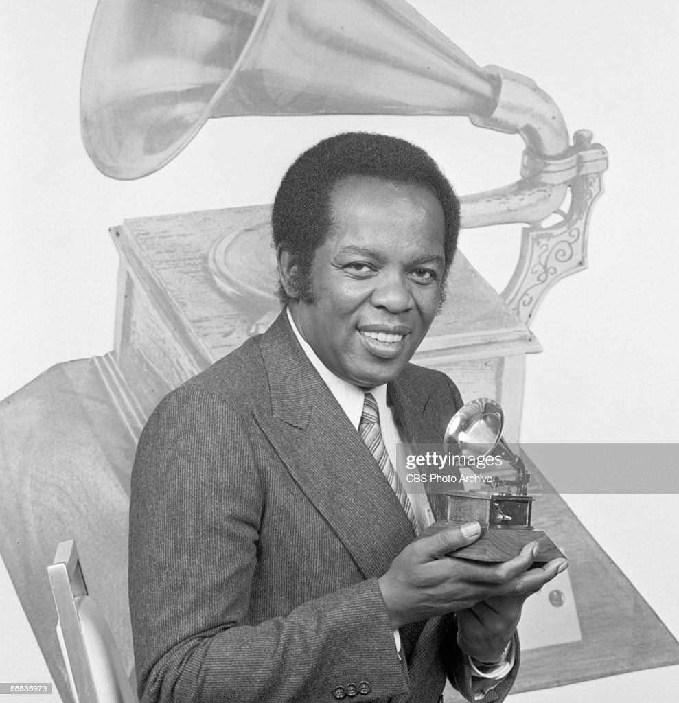Lou Rawls with a Grammy award, in advance of the 22nd Annual Grammy Awards. Image dated January 8, 1980.