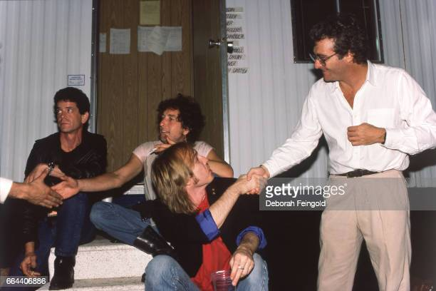 Lou Reed Bob Dylan Tom Petty and Randy Newman posing on September 22 1985 in Champaign Illinois