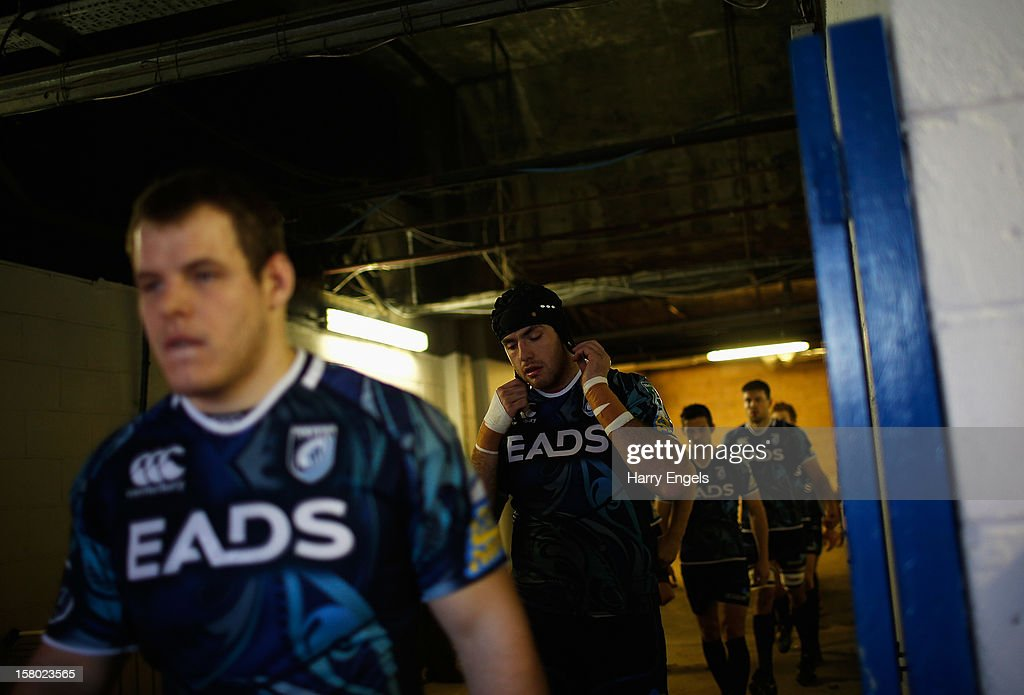 Lou Reed of Cardiff Blues fastens his scrum cap as he walks down the tunnel to the pitch prior to the Heineken Cup match between Cardiff Blues and Montpellier at Cardiff Arms Park on December 9, 2012 in Cardiff, Wales.