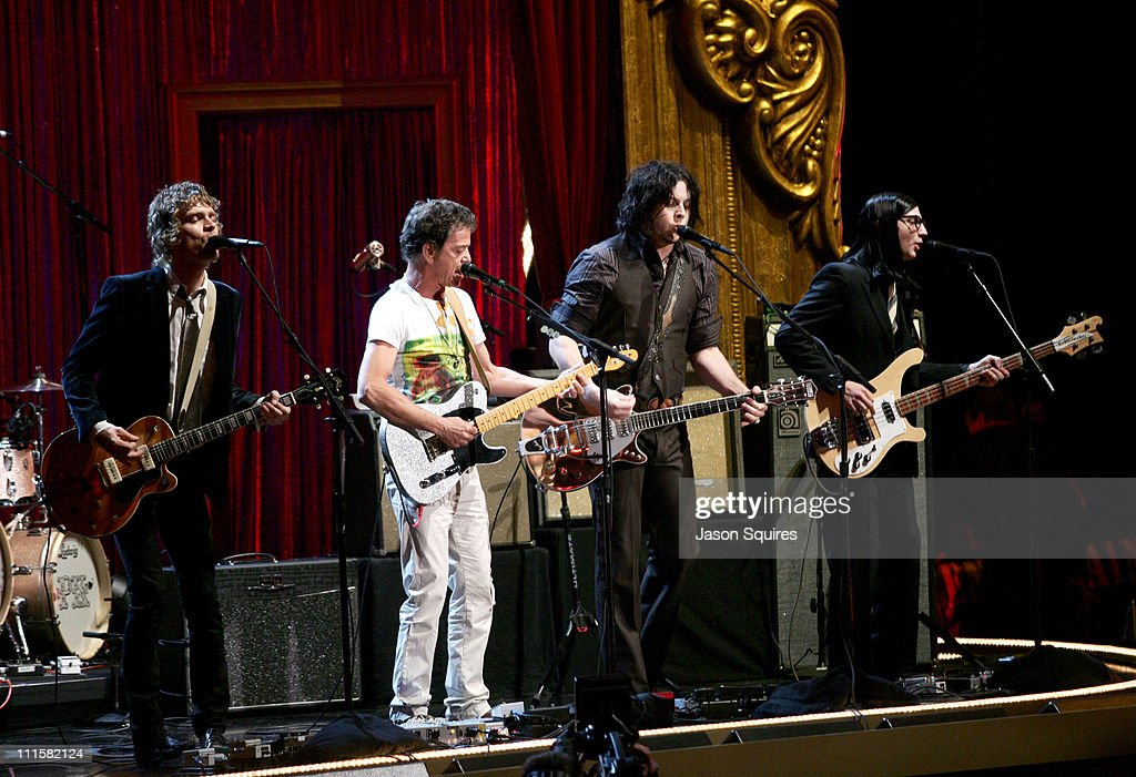 Lou Reed (center left) performs 'White Light/White Heat' with Brendan Benson, Jack White and Jack Lawrence of the Raconteurs