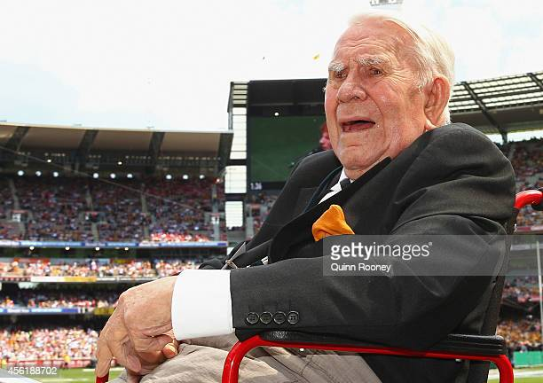 Lou Richards acknowledges the crowd during the Retiring Players Motorcade before the start of the 2014 AFL Grand Final match between the Sydney Swans...