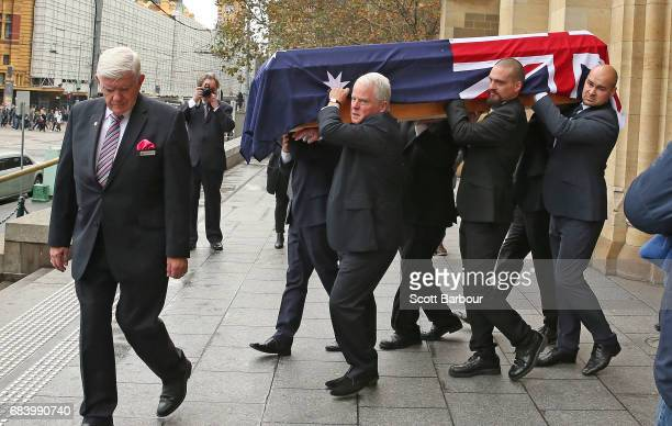 Lou Richards coffin is carried from the Cathedral at the conclusion of the Lou Richards State Funeral Service at St Paul's Cathedral on May 17 2017...