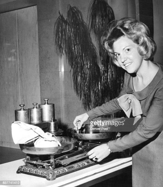 Lou Rupert born somewhat later than the old gold scales she is demonstrating shows the close link between 104 years ago when the Colorado National...