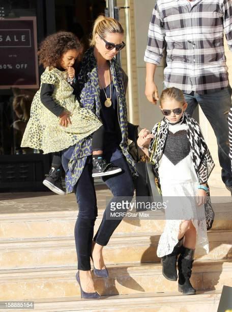 Lou Sulola Samuel Heidi Klum and Leni Samuel as seen on January 2 2013 in Los Angeles California