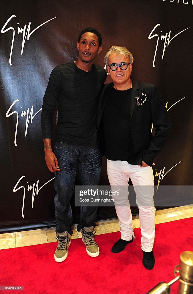 Lou Williams of the Atlanta Hawks (L) and Giuseppe Zanotti attend the Opening Party for the Giuseppe Zanotti Store at Phipps Plaza on October 11, 2013 in Atlanta, Georgia.