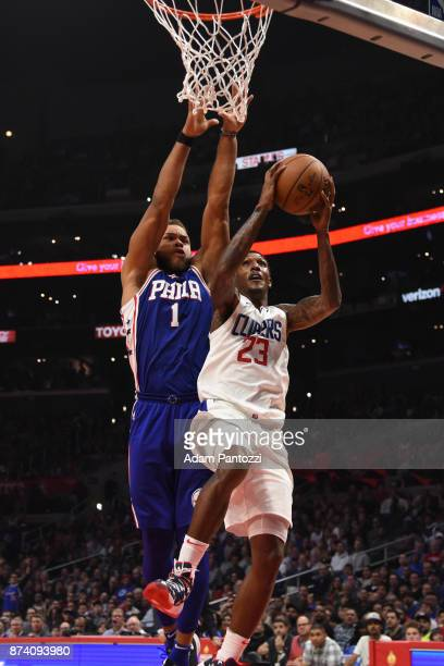 Lou Williams of the LA Clippers drives to the basket against Justin Anderson of the Philadelphia 76ers on November 13 2017 at STAPLES Center in Los...