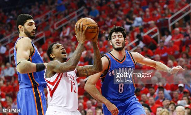 Lou Williams of the Houston Rockets drives between Enes Kanter of the Oklahoma City Thunder and Alex Abrines during Game Five of the Western...