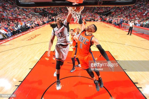 Lou Williams of the Houston Rockets dunks against Russell Westbrook of the Oklahoma City Thunder during the game on March 26 2017 at the Toyota...