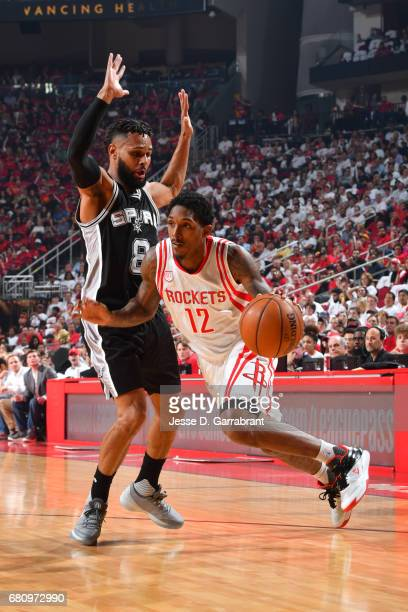 Lou Williams of the Houston Rockets handles the ball against Patty Mills of the San Antonio Spurs in Game Three of the Western Conference Semifinals...