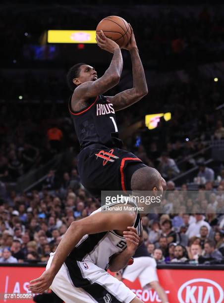 Lou Williams of the Houston Rockets shoots against Tony Parker of the San Antonio Spurs during Game Two of the NBA Western Conference SemiFinals at...