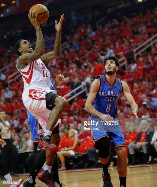 Lou Williams of the Houston Rockets shoots as Alex Abrines of the Oklahoma City Thunder looks on during Game Five of the Western Conference...