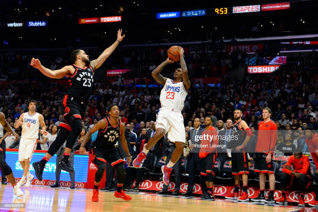 Lou Williams #23 of the Los Angeles Clippers attempts a jump shot against Fred VanVleet #23 of the Toronto Raptors on December 11, 2017 at STAPLES Center in Los Angeles, California.