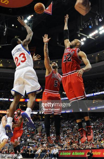 Lou Williams of the Philadelphia 76ers Carlos Boozer and Taj Gibson of the Chicago Bulls jump for a rebound in Game Four of the Eastern Conference...