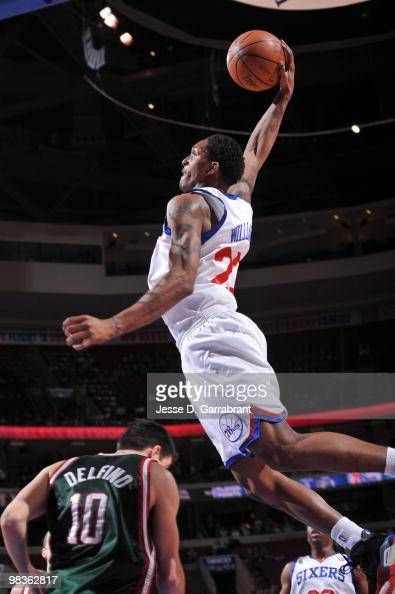 Lou Williams of the Philadelphia 76ers shoots against Carlos Delfino of the Milwaukee Bucks during the game on April 9 2010 at the Wachovia Center in...